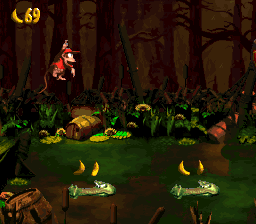 Diddy Kong jumping to some Krockheads in Krockhead Klamber from Donkey Kong Country 2: Diddy's Kong Quest