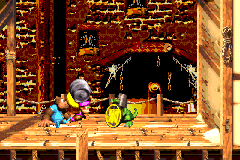 Dixie Kong holding a Steel Barrel toward Koin in Squeals on Wheels in the Game Boy Advance remake of Donkey Kong Country 3
