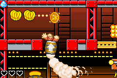 Donkey Kong jumps up to the gold medal of K. Kruizer III Engine in DK: King of Swing
