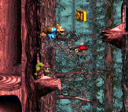Kiddy Kong jumps to a Knik-Knak, with the letter N above it, in Springin' Spiders
