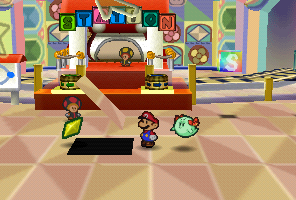 Mario finding a Star Piece in front of the red station in Shy Guy's Toy Box in Paper Mario