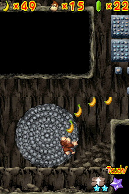 Donkey Kong spinning on a boulder in Cool Cool Cave of DK: Jungle Climber.