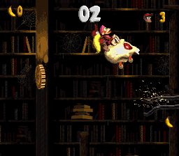 Diddy and Dixie jump backward to the Kremkoin in the first Bonus Area of Haunted Hall.