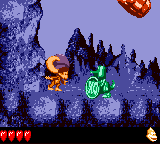 Dixie Kong holds a Steel Barrel at the Koin in Ghoulish Grotto from Donkey Kong GB: Dinky Kong & Dixie Kong