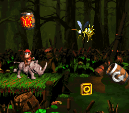 Diddy Kong and Rambi riding toward the letter O in Barrel Bayou in Donkey Kong Country 2: Diddy's Kong Quest.