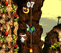 Dixie Kong blasting from an Arrow Barrel in the first Bonus Level of Kong-Fused Cliffs