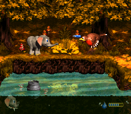 Ellie the Elephant releases a water projectile at a Booty Bird in Bobbing Barrel Brawl from Donkey Kong Country 3: Dixie Kong's Double Trouble!