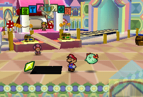 Mario finding a Star Piece in front of the pink station in Shy Guy's Toy Box in Paper Mario
