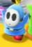 A cyan Shy Guy in Yoshi's Crafted World.