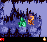 Dixie Kong holding a Steel Barrel at a Koin in Haunted Hollows from Donkey Kong GB: Dinky Kong & Dixie Kong