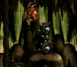 Donkey Kong and Diddy Kong progressing through the Manic Mincers level in the Chimp Caverns.