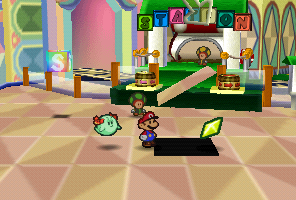 Mario finding a Star Piece in front of the green station in Shy Guy's Toy Box in Paper Mario