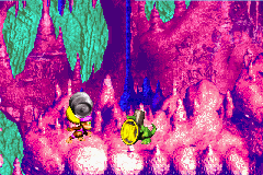 Dixie Kong holding a Steel Barrel at the Koin of Floodlit Fish in the Game Boy Advance version of Donkey Kong Country 3
