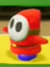A red Shy Guy in Yoshi's Crafted World.