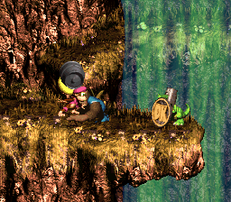 Dixie Kong holding a Steel Barrel to the Koin of Tracker Barrel Trek in Donkey Kong Country 3: Dixie Kong's Double Trouble!
