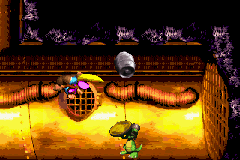 Dixie Kong throwing a Steel Barrel at the wall behind Koin of Surf's Up in the Game Boy Advance version of Donkey Kong Country 3