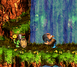 Donkey Kong Country 3: Dixie Kong's Double Trouble!: Kiddy Kong holding a  Steel Barrel at a Koin in Rocket Barrel Ride