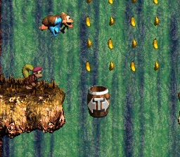 Kiddy Kong jumping into a Tracker Barrel in the level Tracker Barrel Trek from Donkey Kong Country 3: Dixie Kong's Double Trouble!