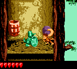 Dixie Kong holding a Steel Barrel at Koin in Simian Shimmy in Donkey Kong GB: Dinky Kong & Dixie Kong