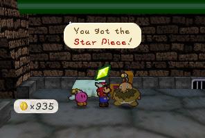 Mario getting a Star Piece from Rip Cheato in Paper Mario