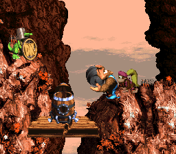 Donkey Kong Country 3: Dixie Kong's Double Trouble!: Kiddy Kong holding a Steel Barrel at a Koin at the end of Rocket Rush