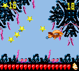 Dixie Kong swims to some stars in the first Bonus Level of Deep Reef Grief in Donkey Kong GB: Dinky Kong & Dixie Kong