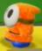 An orange Shy Guy in Yoshi's Crafted World.