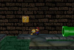 Image of Mario revealing a hidden ? Block in Toad Town Tunnels, in Paper Mario.