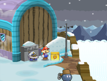 Mario next to the Shine Sprite at the very right of Fahr Outpost's village in Paper Mario: The Thousand-Year Door.