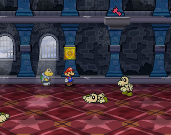 Mario next to the Shine Sprite in the stair switch room in Hooktail Castle in Paper Mario: The Thousand-Year Door.