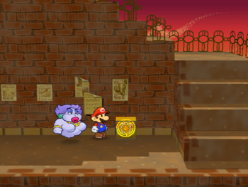 Mario next to the Shine Sprite in the sunset area of Riverside Station in Paper Mario: The Thousand-Year Door.