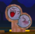 A Wooden cutout of two Boos in Mario Kart Tour.