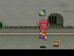 Screenshot of Mario revealing a hidden ? Block (containing a Pretty Lucky badge) in Rogueport Sewers, in Paper Mario: The Thousand-Year Door.