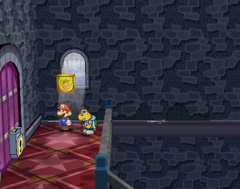Mario next to the Shine Sprite in the high room in Hooktail Castle in Paper Mario: The Thousand-Year Door.