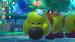 Mario pets Wiggler in Don't Wake Wiggler! from Super Mario Party