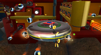 Mario collecting coins and dodging obstacles on the Moving Saucer planet in Battlerock Galaxy.