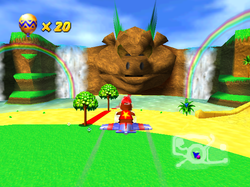 Diddy Kong flying in his plane in the center of Timber's Island in Diddy Kong Racing