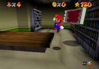 Mario jumping away from a Bookend.