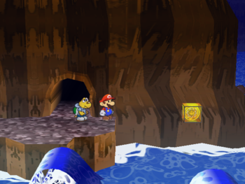 Mario next to the Shine Sprite above water in the Pirate's Grotto in Paper Mario: The Thousand-Year Door.