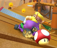 The icon of the Wario Cup challenge from the New Year's Tour and the Rosalina Cup challenge from the 2020 Winter Tour in Mario Kart Tour