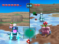 Screenshot of the duel in Random Ruckus from Mario Party 5. This is a tournament match on hard difficulty, where Mario is a player while Wario is a CPU.