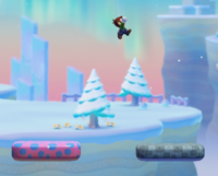 Luigi near some on-off trampolines. On the left is the activated version, the right one is the deactivated version.