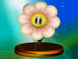 Artwork for the Fire Flower in Super Mario Bros. (left) The design of the Fire Flower in Super Smash Bros. Melee (right)