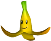 Mario Kart Double Dash!! promotional artwork: A Banana Peel with the common symbol of the eyes