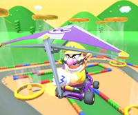 The icon of the Wario Cup challenge from the Baby Rosalina Tour and the Hammer Bro Cup challenge from the 2021 Trick Tour in Mario Kart Tour