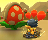 The icon of the Yoshi Cup challenge from the Marine Tour and the Peachette Cup challenge from the Wedding Tour in Mario Kart Tour.