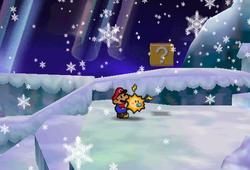 Image of Mario revealing a hidden? Block in Shiver Snowfield, in Paper Mario.