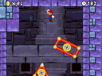 Mario using the moving platforms in 2-Tower