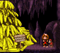 The Kongs celebrate their recovered banana hoard in the original (left) and the Game Boy Color version (right).