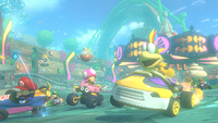 Larry Koopa races in the underwater portion of the Water Park stage in Mario Kart 8.